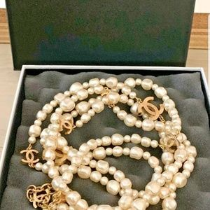 FAUX PEARL NECKLACE BY DESIGNER CHANEL.